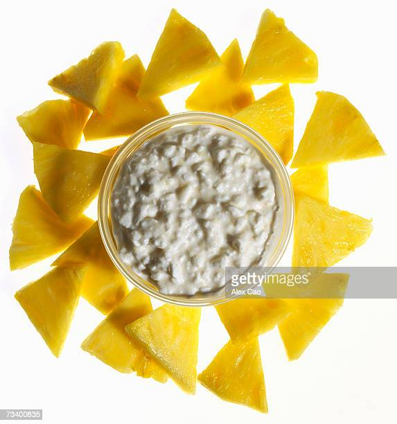 Pineapple triangles served with bowl of cottage cheese