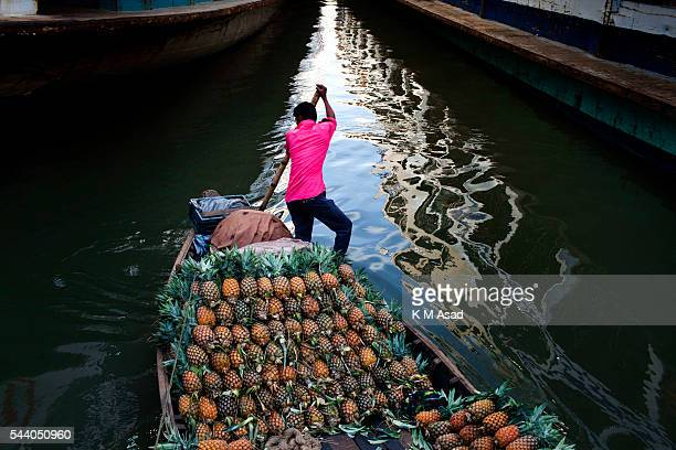 SADARGHAT DHAKA BANGLADESH A pineapple vendor sells his produce Bangladesh is one of the most densely populated countries in the world where 28000...