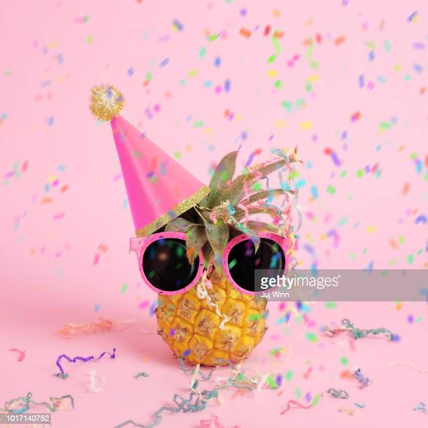 Pineapple with party hat and confetti