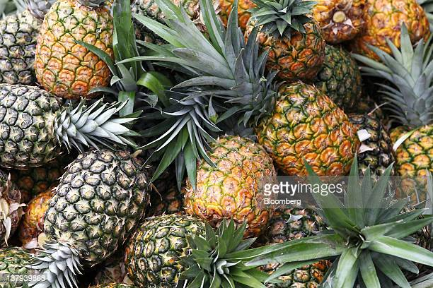 Pineapples are stacked at a Dole Food Co plantation in Polomolok the Philippines on Thursday Jan 26 2012 Philippine economic growth accelerated for a...