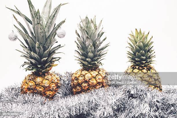 Pineapples On Tinsels Against Wall