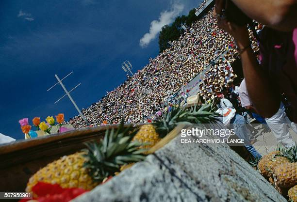 Pineapples ready to be launched to the public during the celebrations at the Guelaguetza festival Oaxaca Mexico