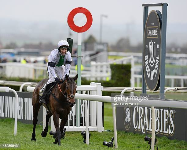 Pineau de Re ridden by Leighton Aspell crosses the finishing line to win the Grand National horse race at Aintree Racecourse in Liverpool northwest...
