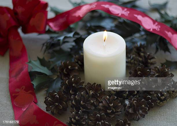 Pinecones and a candle
