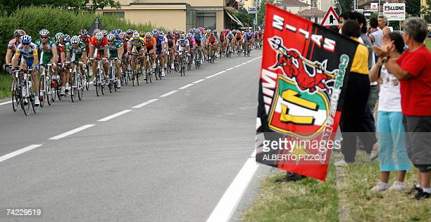 AC Milan supporters looks at the riders as they pedal during the eleventh stage of the Giro d'Italia cycling racea 198 km leg ran from Serravalle...