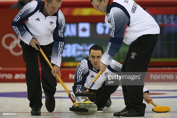 Britain's skip David Murdoch releases the stone during their match against Canada in the men's curling round-robin of the 2006 Turin Winter Olympic...