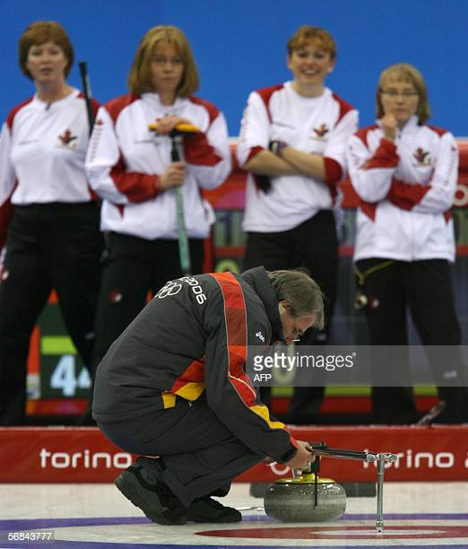 Canada's curlers (background watch as an official mesures distances between stones during their Curling match against the US in the women's...