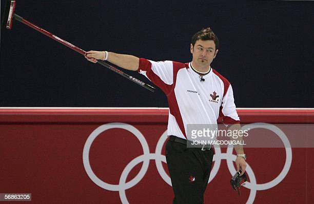 Canada's Jamie Korab waves to the crowd after Canada defeated Norway in the men's round robin curling event at the 2006 Turin Winter Olympic Games in...