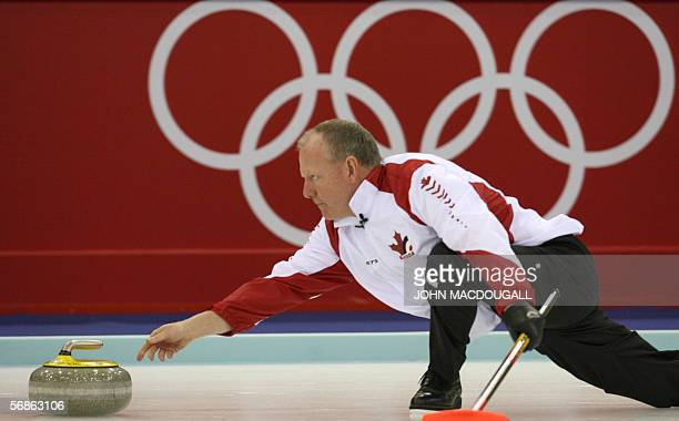 Canada's skip Russ Howard releases the stone during their match against Norway in the men's round robin curling event at the 2006 Turin Winter...
