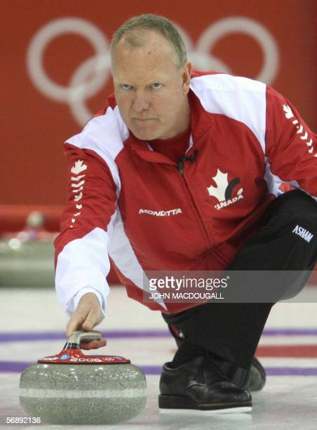 Canada's skip Russ Howard releases the stone during the Canada vs USA match in the men's round robin curling event at the 2006 Turin Winter Olympic...