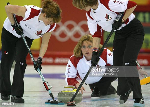 Canada's skip Shannon Kleibrink releases the stone during the Denmark vs Canada match in the women's round robin curling event at the 2006 Turin...