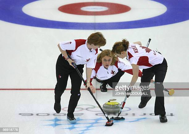 Canadian skip Shannon Kleibrink releases the stone during the Canada vs Norway match in the women's curling battle for bronze at the 2006 Turin...