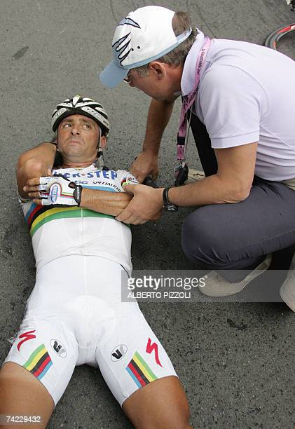 Italy's Paolo Bettini lies after crashing during the final sprint of the eleventh stage of the Giro d'Italia cycling race a 198 km leg from...