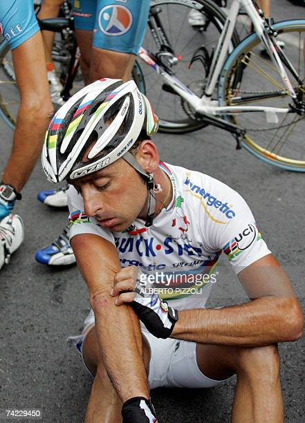 Italy's Paolo Bettini lies after crashing during the final sprint of eleventh stage of the Giro d'Italia cycling race 198 km leg from Serravalle...