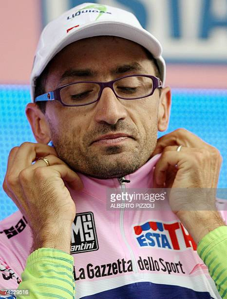 Italy's rider Andrea Noe wears the leader's pink jersey on the podium after the eleventh stage of the Giro d'Italia cycling race 198 km leg from...