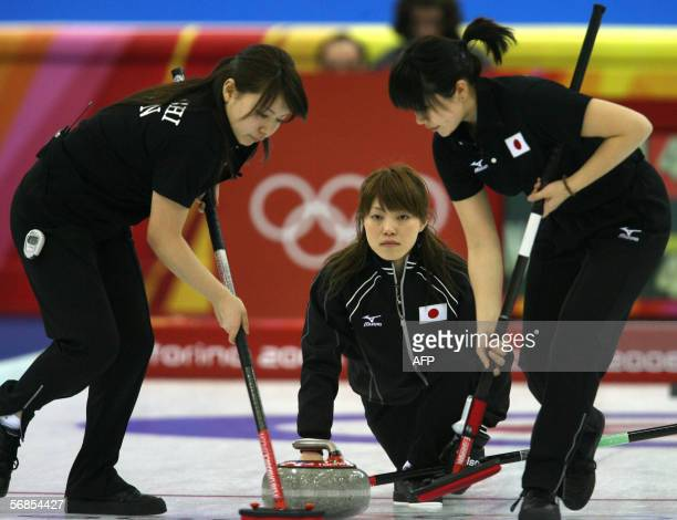 Japan's skip Ayumi Onodera releases the stone during their match against Norway in the women's round robin curling event at the 2006 Turin Winter...