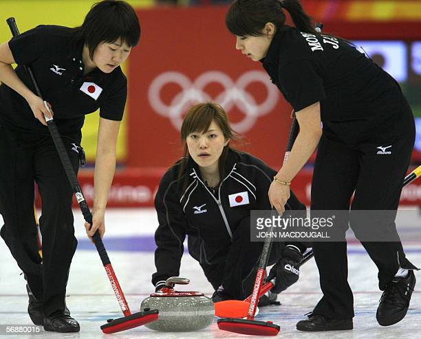 Japan's skip Ayumi Onodera releases the stone during the Japan vs Sweden match in the women's round robin curling event at the 2006 Turin Winter...