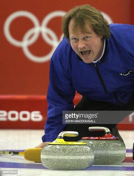 Norway's skip Pal Trulsen shouts directions during their Curling match against Sweden in the men's round-robin of the 2006 Turin Winter Olympic...
