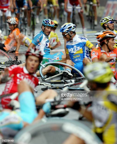 Riders lies after crashing during the final sprint of eleventh stage of the Giro d'Italia cycling race 198 km leg from Serravalle Scrivia to Pinerolo...