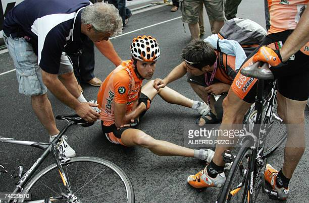 Spanish rider Aitor Gutierrez Hernandez lies after crashing during the final sprint of the eleventh stage of the Giro d'Italia cycling race 198 km...