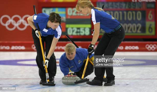 Sweden's skip Anette Norberg releases the last stone during the women's curling final at the 2006 Turin Winter Olympic Games, in Pinerolo 23 February...