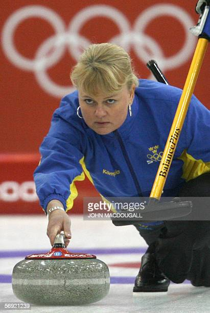 Sweden's skip Anette Norberg releases the stone during the women's curling final at the 2006 Turin Winter Olympic Games, in Pinerolo 23 February...