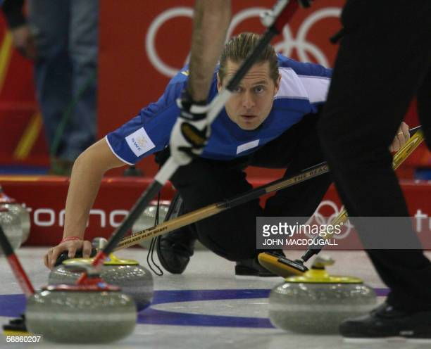 Sweden's Skip Peja Lindholm directs a throw during their match against Norway in the men's round robin curling event at the 2006 Turin Winter Olympic...