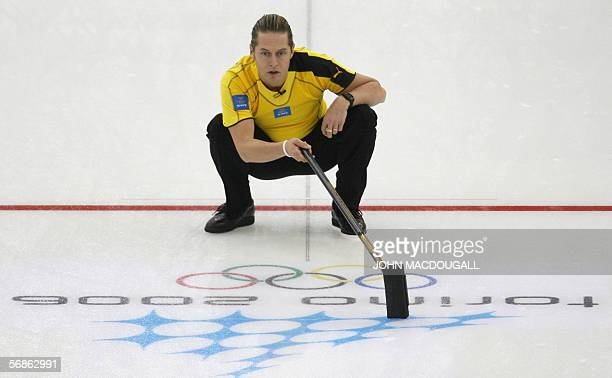 Sweden's skip Peja Lindholm follows his throw during their match against the USA in the men's round robin curling event at the 2006 Turin Winter...