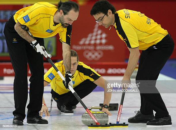 Sweden's skip Peja Lindholm releases the stone during their match against the USA in the men's round robin curling event at the 2006 Turin Winter...