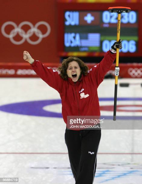 Switzerland's skip Mirjam Ott celebrates after throwing the last stone during the Switzerland vs USA match in the women's round robin curling event...