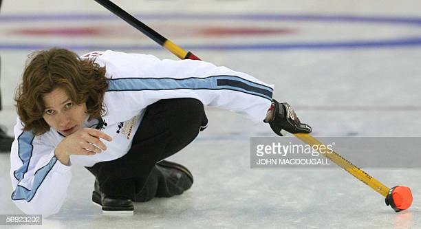 Switzerland's skip Mirjam Ott follows her last throw during the women's curling final at the 2006 Turin Winter Olympic Games, in Pinerolo 23 February...