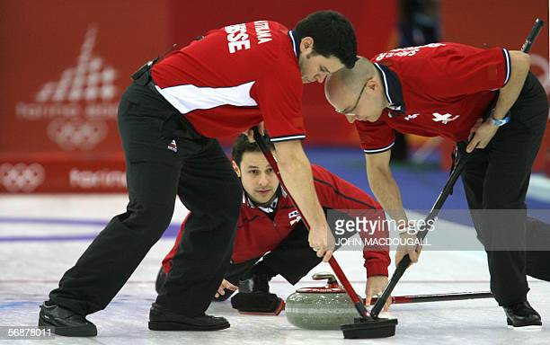 Switzerland's skip Ralph Stoeckli reases the stone during the Britain vs Switzerland match in the men's round robin curling event at the 2006 Turin...