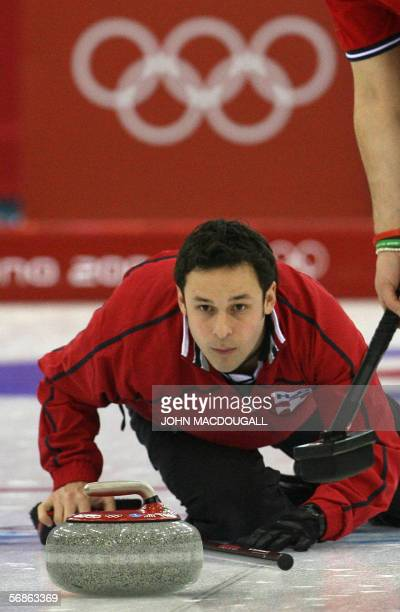 Switzerland's skip Ralph Stoeckli releases the stone during their match against New Zealand in the men's round robin curling event at the 2006 Turin...