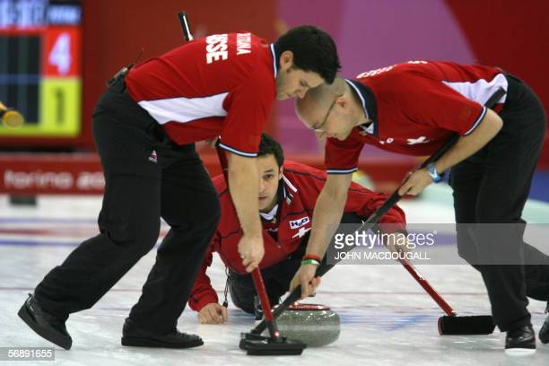 Switzerland's skip Ralph Stoeckli releases the stone during the Italy vs Switzerland match in the men's round robin curling event at the 2006 Turin...