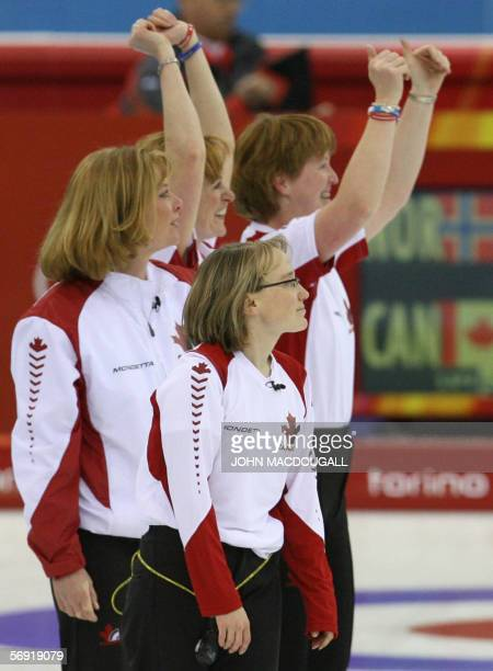 The Canadian women's curling team celebrate with supporters after the Canada vs Norway match in the women's curling battle for bronze at the 2006...
