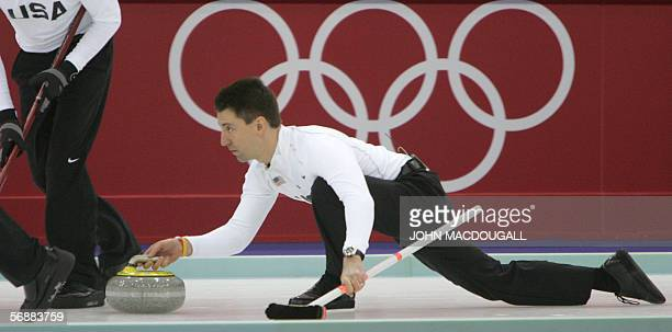 The US' skip Pete Fenson releases the stone during the Britain vs USA match in the men's round robin curling event at the 2006 Turin Winter Olympic...