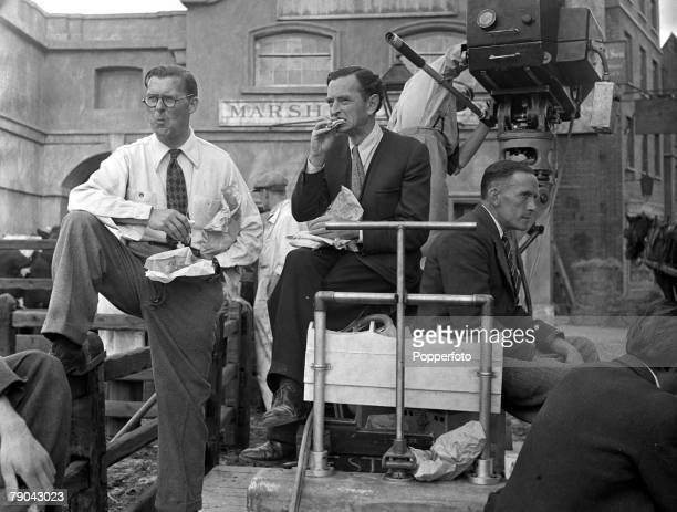 1947 Pinewood Studios London England A picture of filming on the set of the movie version of the Charles Dickens novel Oliver Twist Seated is British...