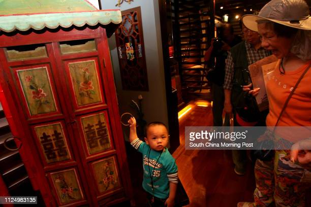 Ping Shan Tang Clan Gallery Opening Ceremony Pictured is Gay Sunlee holding a Bridal sedan chair used in traditional marriages His grand dad is an...