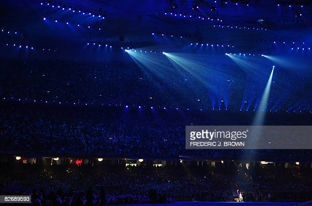 Ping Yali the first Paralympic gold medallist in China's history carries the torch during the opening ceremony for the 2008 Beijing Paralympic Games...