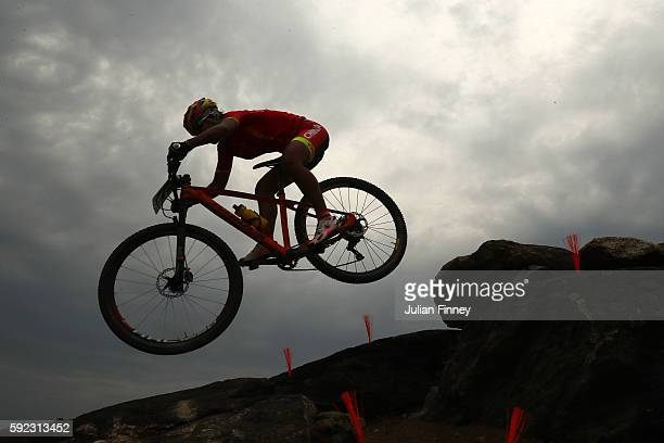 Ping Yao of China races during the Women's Cross-Country Mountain Bike Race on Day 15 of the Rio 2016 Olympic Games at the Mountain Bike Centre on...