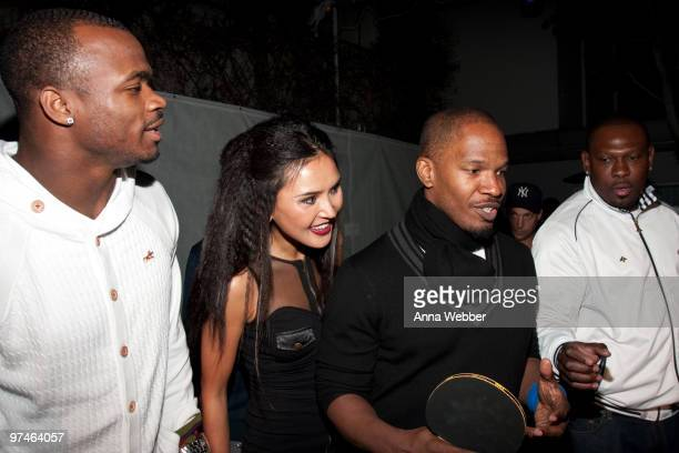 Pingpong champion Soo Yeon Lee Jamie Foxx and guests attend the ESPiN NYC PreOscar Party at Mondrian LA's SKYBAR on March 4 2010 in West Hollywood...