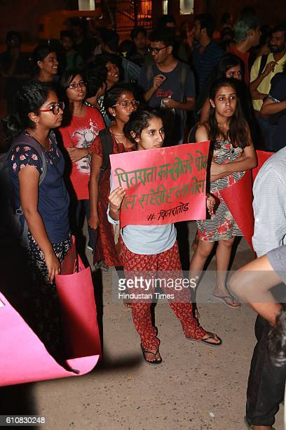 Pinjra Tod, a women collective body across universities, organise a night march in the North Campus of Delhi University on September 23, 2016 in New...