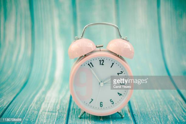 pink alarm clock in pastel colorful background.top view - daylight saving time stock pictures, royalty-free photos & images