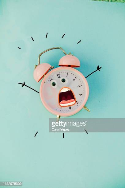 pink alarm clock in pastel colorful background.top view - funny wake up stock pictures, royalty-free photos & images