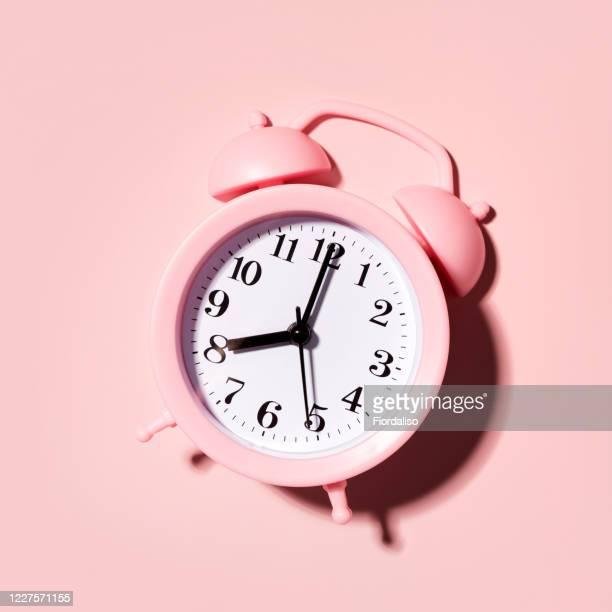 pink alarm clock - routine stock pictures, royalty-free photos & images