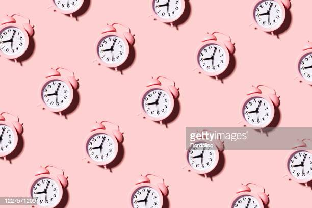 pink alarm clock - alarm clock stock pictures, royalty-free photos & images