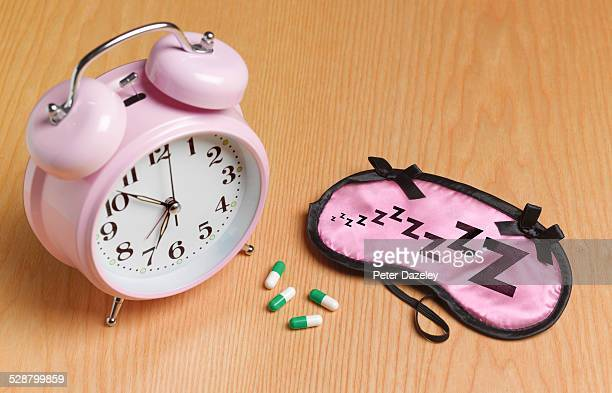 Pink alarm mask and sleeping pills