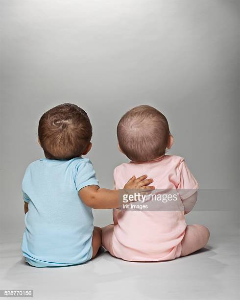 pink and blue babies together - baby girls stock photos and pictures