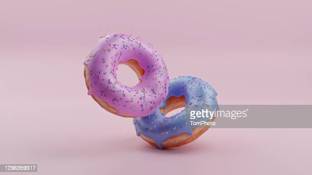 pink and blue donuts on pink background - ドーナツ ストックフォトと画像