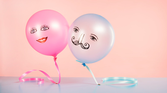 pink and blue helium balloons with smiling faces floating - gettyimageskorea